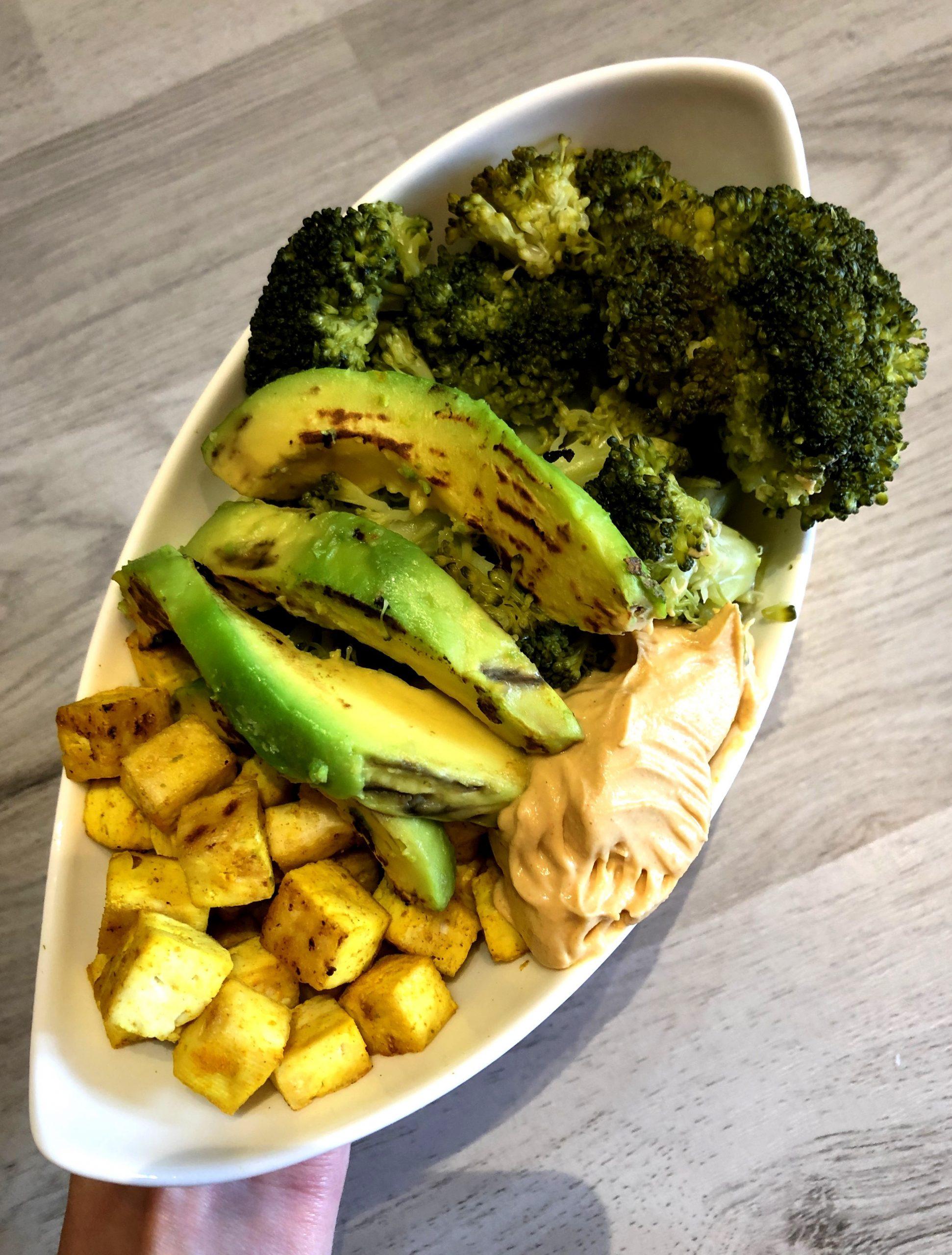Vegan broccoli bowl with hummus and tofu