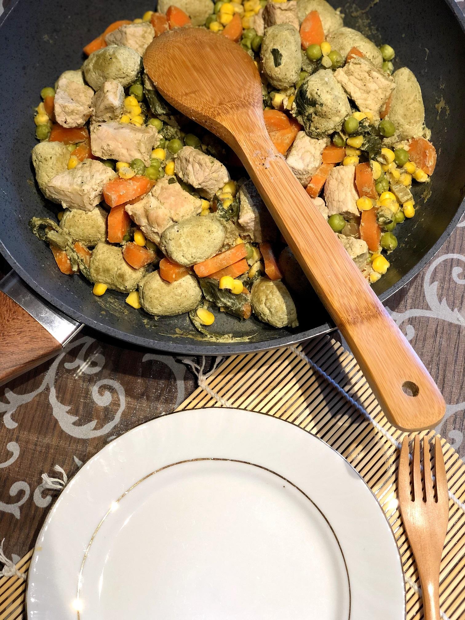 Pork-vegetables with pumpkin seed dumplings and pesto