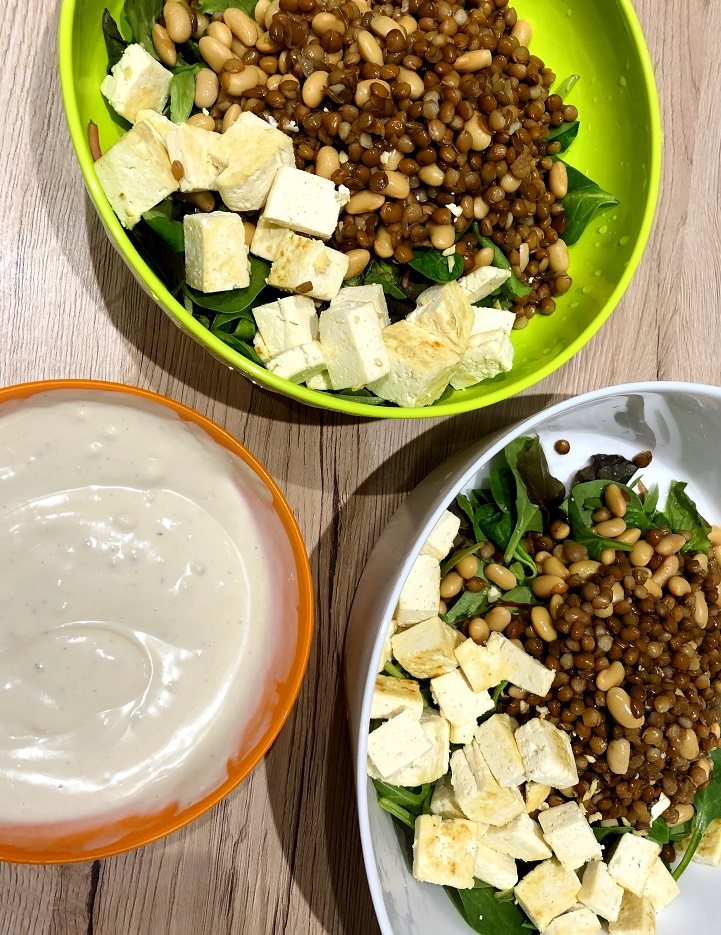 Salad bowl with lentils, soy, tofu and hummus dressing