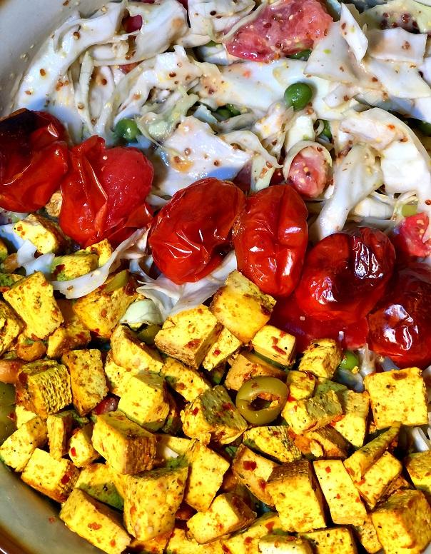Vegan salad bowl with tofu and mustard dressing